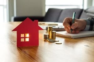 What ongoing expenses are involved with property investment?